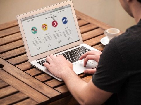 Man on laptop outsourcing tasks to a Virtual Assistant