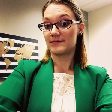 Tayler In Office Wearing Green Jacket