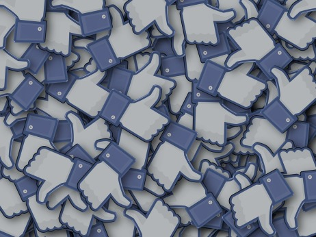 Facebook Thumbs up icons overlayed on one another creating a cluster of likes... sort of just like how Facebook makes my brain feel.