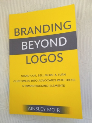 Branding Beyond Logos to Stand Out, Sell More and Turn Customers into Advocates with These 17 Brand Building Elements Book Written by Ainsley Moir